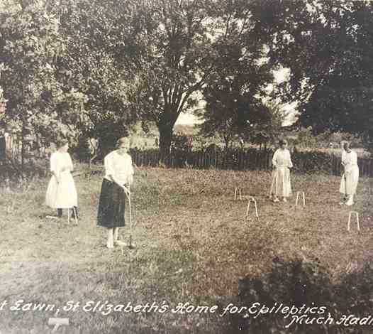 Playing Croquet on the Lawn - 1908
